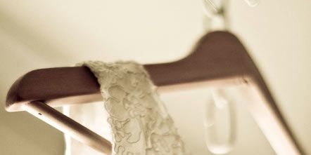 Textile, White, Room, Clothes hanger, Linens, Pattern, Home accessories, Beige, Interior design, Household supply,