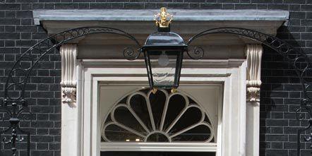 Architecture, Door, Home door, Fixture, Door handle, Iron, Metal, Handle, Molding, Household hardware,