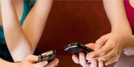 Finger, Hand, Wrist, Joint, Human leg, Nail, Thumb, Mobile phone, Denim, Thigh,