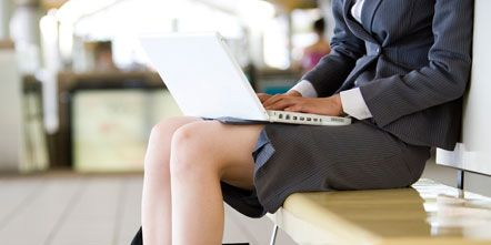 Human leg, Sitting, Foot, Knee, Street fashion, Laptop, Reading, Communication Device, Ankle, Suit trousers,