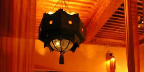 Lighting, Interior design, Room, Hearth, Amber, Light fixture, Interior design, Ceiling, Lighting accessory, Tints and shades,