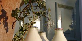 White, Bottle, Room, Wall, Interior design, Artifact, Beige, Interior design, Vase, Dairy,