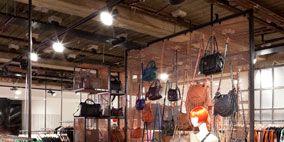 Lighting, Textile, Tablecloth, Ceiling, Interior design, Light fixture, Clothes hanger, Linens, Beam, Retail,