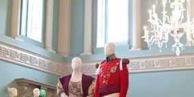 Human body, Stage, Gown, Sculpture, Costume design, Costume, Scene, Victorian fashion, One-piece garment, Statue,