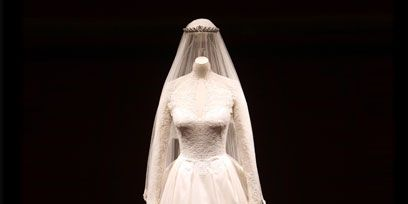 Clothing, Dress, Bridal clothing, Bridal veil, Sleeve, Shoulder, Textile, Photograph, Veil, Standing,