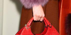 Textile, Red, Carmine, Costume accessory, Fashion, Maroon, Fur, Coquelicot, Pocket, Natural material,