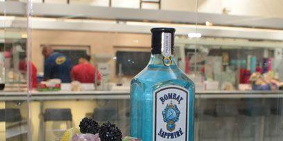 Glass, Drink, Fluid, Liquid, Bottle, Alcoholic beverage, Drinkware, Distilled beverage, Tableware, Logo,