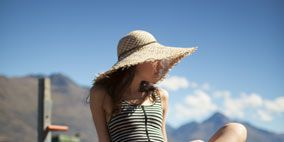 Hat, Wood, Shoulder, Human leg, Photograph, Leisure, Sitting, Elbow, Summer, People in nature,