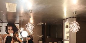Lighting, Interior design, Human body, Room, Light fixture, Floor, Interior design, Ceiling, Ceiling fixture, Lighting accessory,