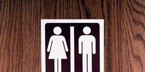 Wood, Hardwood, Wood stain, Sign, Wood flooring, Signage, Holding hands, Plywood, Symbol, Gesture,