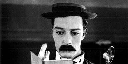Finger, Hand, Cap, Moustache, Publication, Thumb, Peaked cap, Kitchen utensil, Costume hat, Beret,