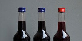 Blue, Product, Brown, Liquid, Glass bottle, Bottle, Drink, Alcoholic beverage, Red, Photograph,