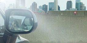 Motor vehicle, Automotive mirror, Mode of transport, Automotive design, Automotive tire, Infrastructure, Automotive exterior, Rim, Alloy wheel, Photograph,