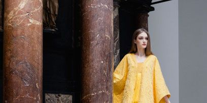 Clothing, Sleeve, Standing, Dress, Street fashion, Fashion, One-piece garment, Column, Fashion model, Fashion design,