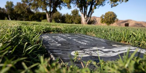 a black headstone marks the grave of juan peña diaz, an undocumented worker from mexico who was killed by anaheim police in 1953