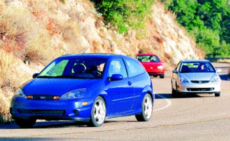 Jackson Racing SVT Focus, Neuspeed GTI, and King Motorsports Civic Si