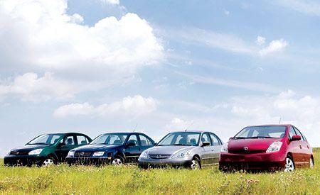 Honda Civic Hybrid vs. Toyota Echo, VW Jetta GLS TDI, Toyota Prius