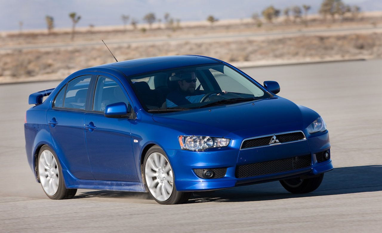 2009 mitsubishi lancer gts comparison tests comparisons car and driver