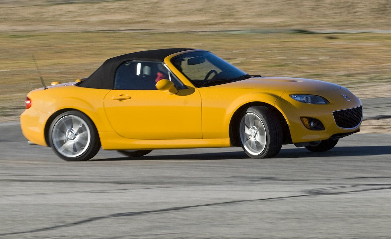https://hips.hearstapps.com/amv-prod-cad-assets.s3.amazonaws.com/images/09q2/267376/2009-mazda-mx-5-miata-grand-touring-photo-266220-s-original.jpg