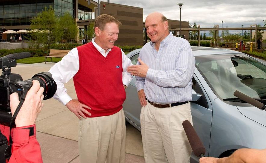 Ford President and CEO, Alan Mulally, delivers Microsoft CEO, Steve Ballmer's, 2010 Fusion Hybrid equipped with 1 millionth Ford Sync system. - Slide 1