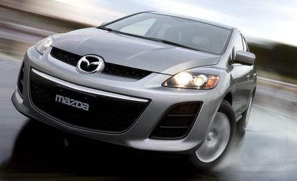 2010 mazda cx 7 i sv review car and driver. Black Bedroom Furniture Sets. Home Design Ideas