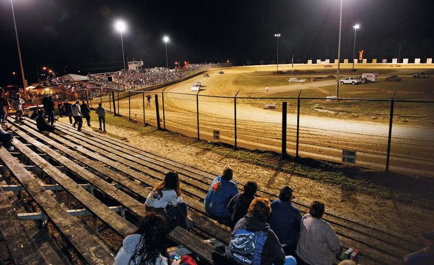 The view from the Ocala Speedway pit-side grandstands: It?s a popular place, but you might get some dirt slung into your sweetened iced tea (no beer allowed in the pits). - Slide 1