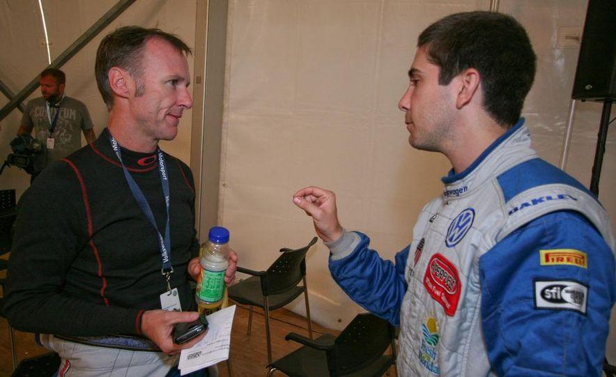 Gillies (left) listens as Mark Pombo dispenses advice. - Slide 1