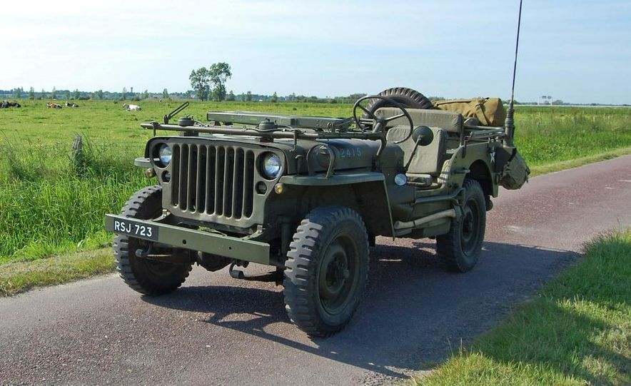 Our '44 Ford GPW, top off and windscreen folded, explores the narrow lanes through the fields north of Carentan where the 101st Airborne fought in the days following June 6. - Slide 1