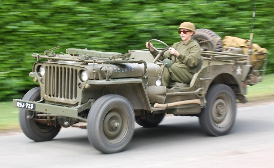 Our '44 Ford GPW, top off and windscreen folded, explores the narrow lanes through the fields north of Carentan where the 101st Airborne fought in the days following June 6. - Slide 19
