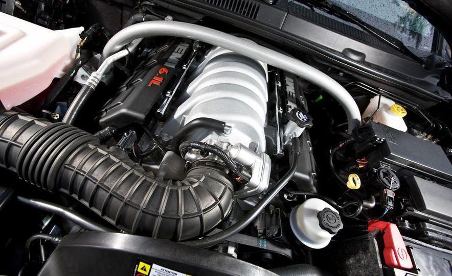 2010 BMW X5 M, 2009 Porsche Cayenne Turbo S, 2010 Jeep Grand Cherokee SRT8, and Land Rover Ranger Rover Sport Supercharged - Slide 56