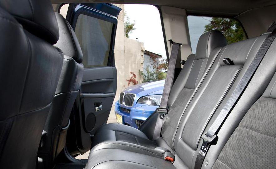 2010 BMW X5 M, 2009 Porsche Cayenne Turbo S, 2010 Jeep Grand Cherokee SRT8, and Land Rover Ranger Rover Sport Supercharged - Slide 55