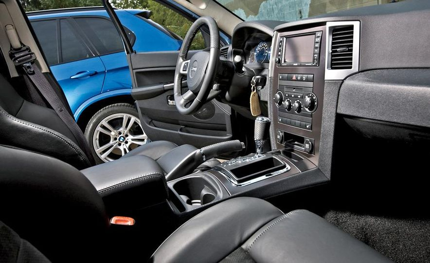2010 BMW X5 M, 2009 Porsche Cayenne Turbo S, 2010 Jeep Grand Cherokee SRT8, and Land Rover Ranger Rover Sport Supercharged - Slide 62