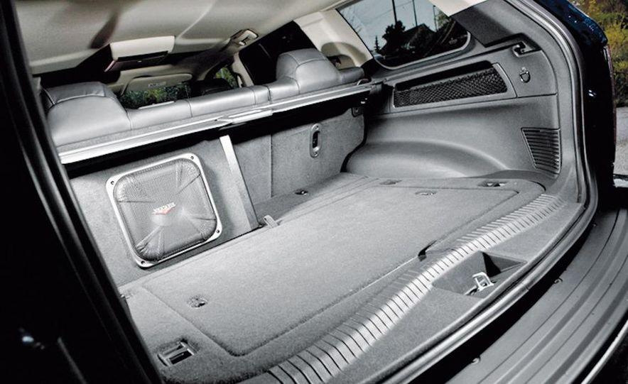 2010 BMW X5 M, 2009 Porsche Cayenne Turbo S, 2010 Jeep Grand Cherokee SRT8, and Land Rover Ranger Rover Sport Supercharged - Slide 61
