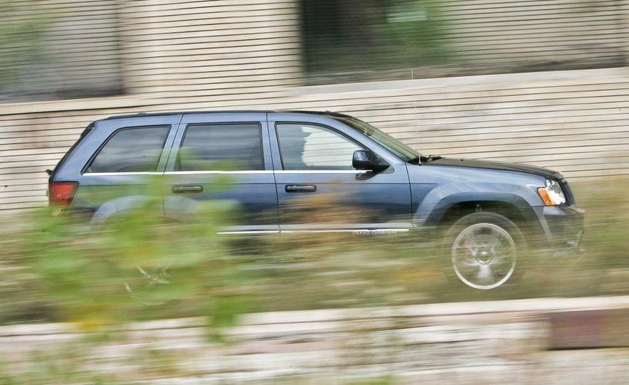 2010 BMW X5 M, 2009 Porsche Cayenne Turbo S, 2010 Jeep Grand Cherokee SRT8, and Land Rover Ranger Rover Sport Supercharged - Slide 51