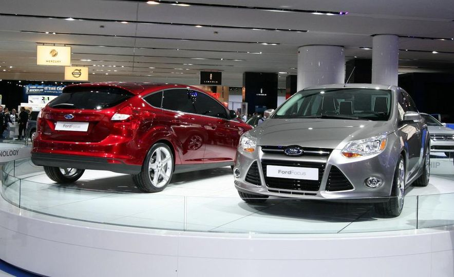 2010 Ford Focus five-door hatchback and 2012 Ford Focus sedan - Slide 1