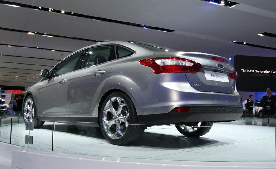 2010 Ford Focus five-door hatchback and 2012 Ford Focus sedan - Slide 7