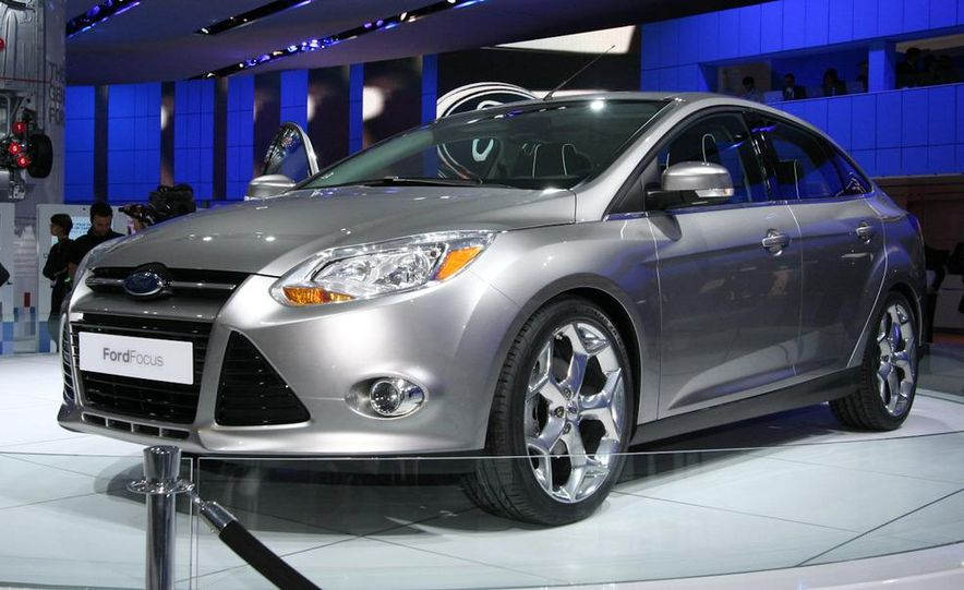 2010 Ford Focus five-door hatchback and 2012 Ford Focus sedan - Slide 8