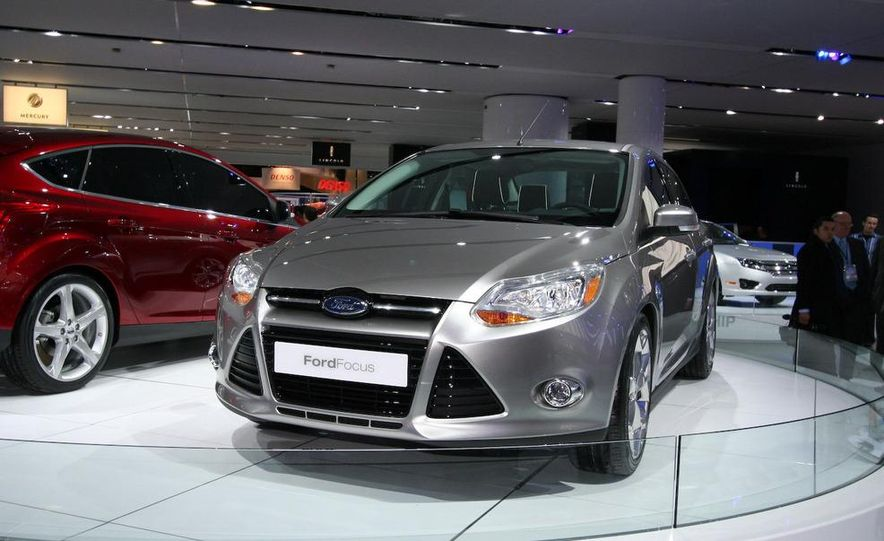 2010 Ford Focus five-door hatchback and 2012 Ford Focus sedan - Slide 2