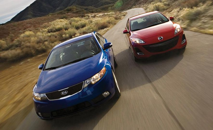 2010 Kia Forte SX and Mazda 3 s 5-door Sport - Slide 1