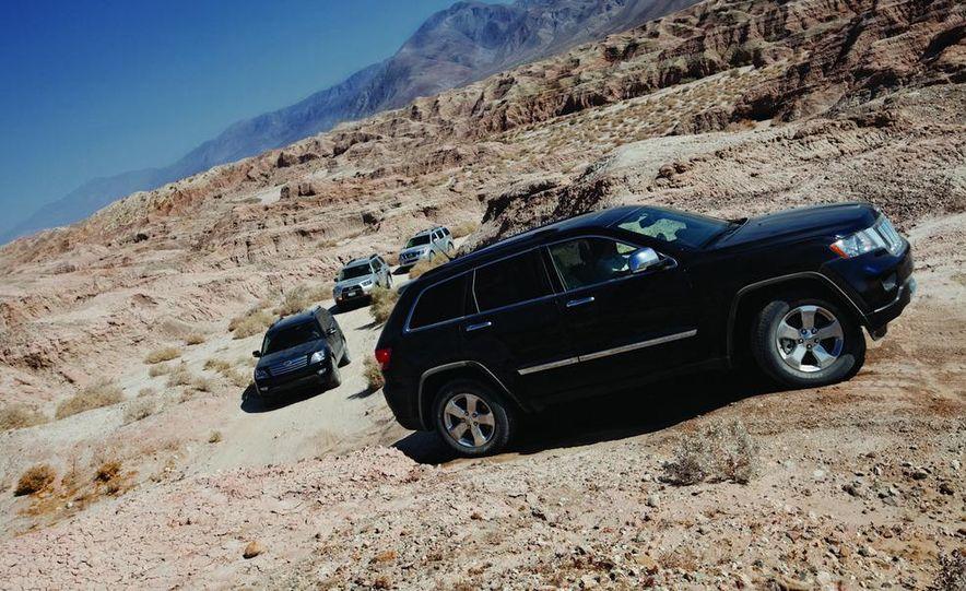 2010 Nissan Pathfinder LE 4x4, 2010 Toyota 4Runner Trail 4x4 V-6, 2009 Kia Borrego Limited 4WD V-8, 2011 Jeep Grand Cherokee Overland 4x4 - Slide 1