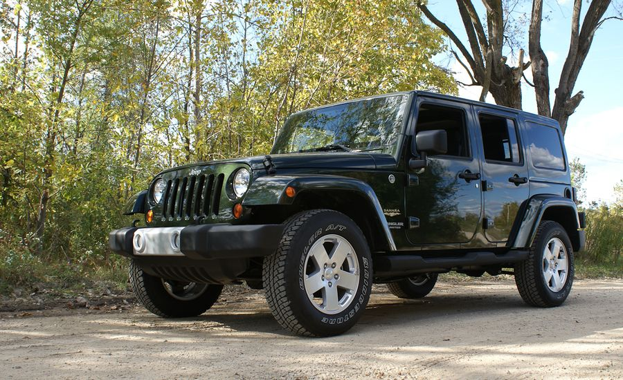 2011 jeep wrangler unlimited sahara 4x4 review car and driver. Black Bedroom Furniture Sets. Home Design Ideas