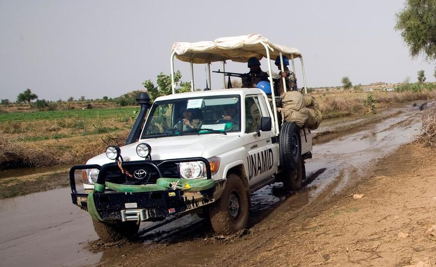 UNMOs work to free their vehicle from the mud as the onset of the rains have made travel in southern Sudan much more difficult due to a lack of infrastructure. - Slide 5