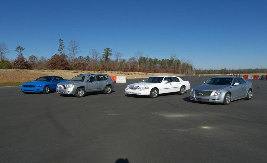 2011 Ford Mustang V-6 Convertible, 2010 Jeep Compass, 2011 Lincoln Town Car, 2010 Cadillac CTS4 - Slide 1