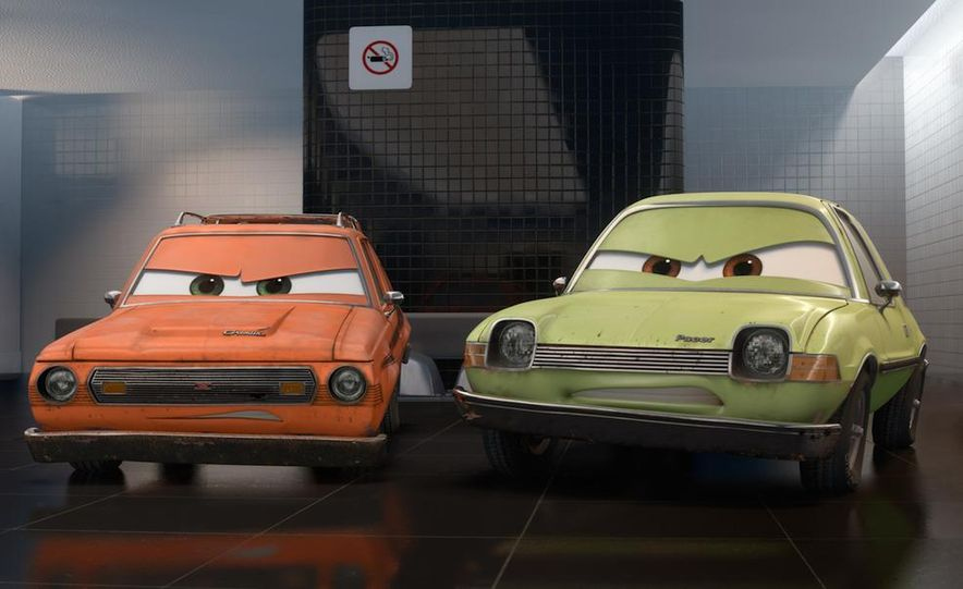 Grem, Acer, Lightning McQueen, Mater, and Finn McMissile in Disney-Pixar's Cars 2 - Slide 3