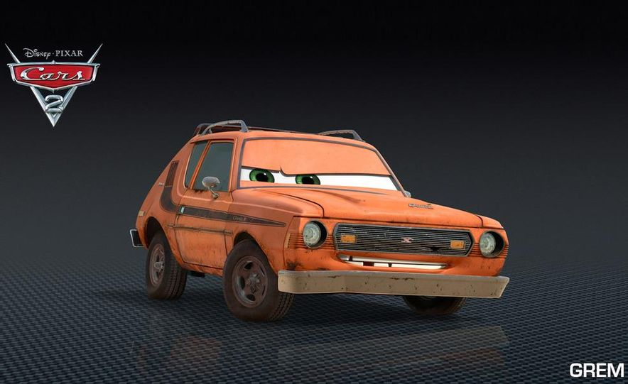 Grem, Acer, Lightning McQueen, Mater, and Finn McMissile in Disney-Pixar's Cars 2 - Slide 16