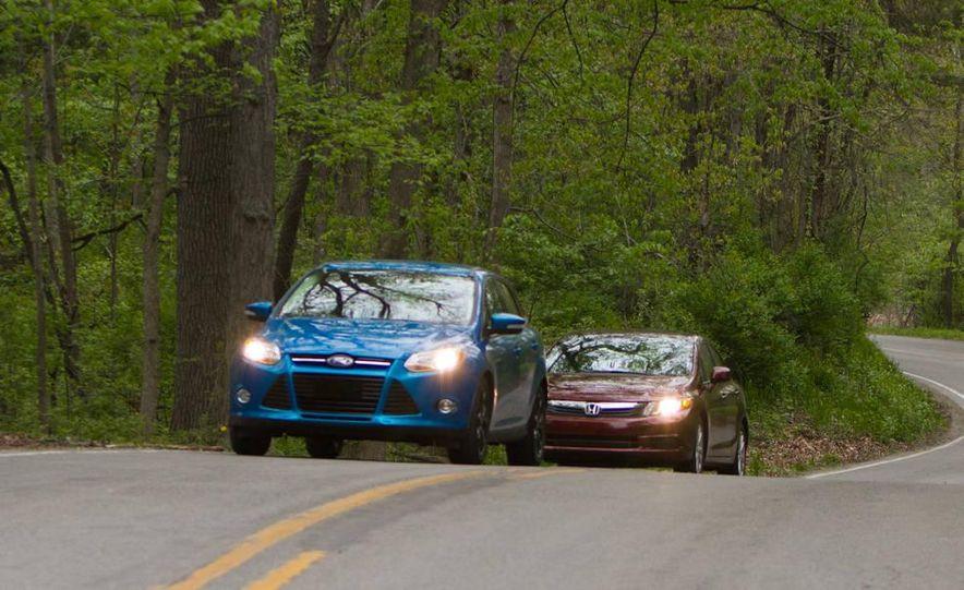 2012 Ford Focus SE sedan and 2012 Honda Civic EX sedan - Slide 1