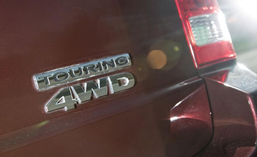 2011 Honda Pilot Touring 4WD, 2011 Dodge Durango Crew AWD, and 2011 Ford Explorer XLT 4WD - Slide 12
