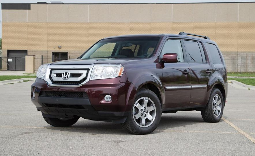 2011 Honda Pilot Touring 4WD, 2011 Dodge Durango Crew AWD, and 2011 Ford Explorer XLT 4WD - Slide 6