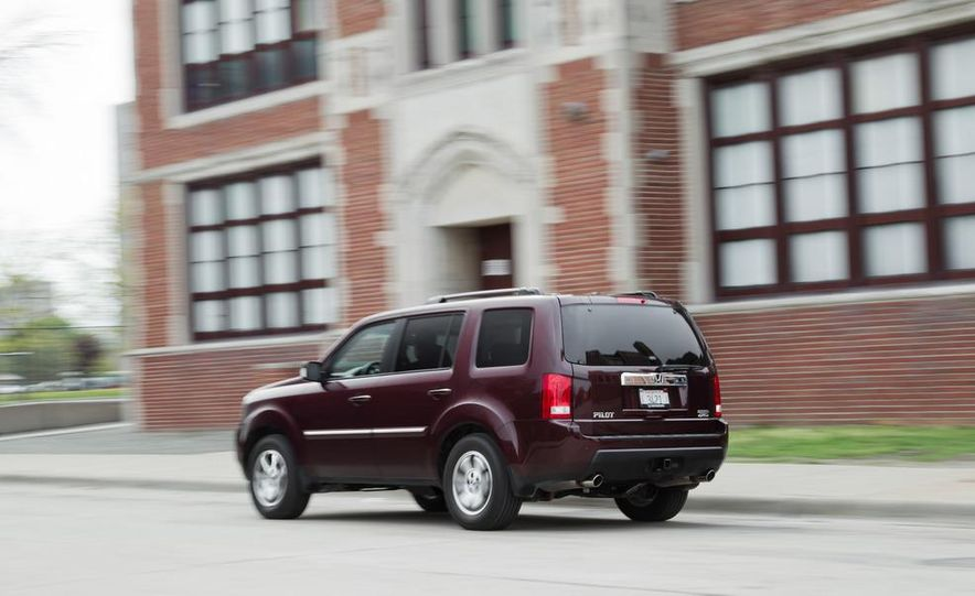 2011 Honda Pilot Touring 4WD, 2011 Dodge Durango Crew AWD, and 2011 Ford Explorer XLT 4WD - Slide 7