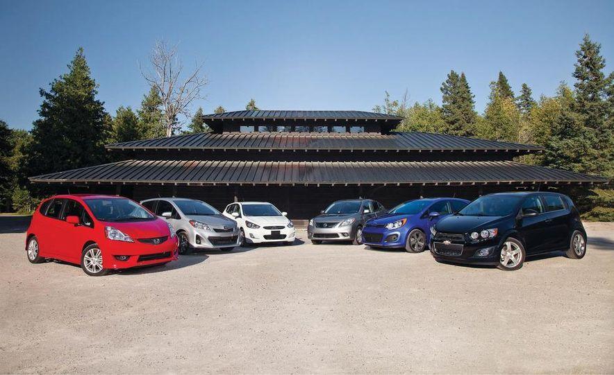 2011 Honda Fit Sport, 2012 Toyota Yaris SE, 2012 Hyundai Accent SE, 2012 Nissan Versa SL, 2012 Kia Rio5 SX, and 2012 Chevy Sonic LTZ Turbo - Slide 1